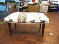 Foot stool with wooden legs