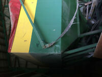 Fertilizer container on wheel with auger and hydraulic valve.