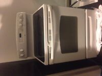 MOVING SALE NEW PRICE $320 GE FLAT TOP STOVE
