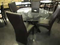 NEW GLASS TABLE AND CHAIRS (DISPLAY MODEL) 600