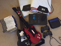 PS2 console, controllers, guitars, eyetoy, dance mats and games