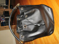 Aritzia brand Auxiliary black leather bag