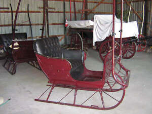 two horse drawn sleighs