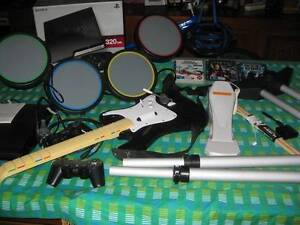 PS3 CONSOLE 320GB/ GAMES/ROCKBAND GUITAR & DONGLE DRUMS Bridgeman Downs Brisbane North East Preview