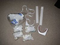BRAND NEW 4 BAGS OF FIXING BUTTONS 25MM PLUS OTHER GUTTERING ITEMS