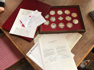 12 silver coins with documents Franklin Mint