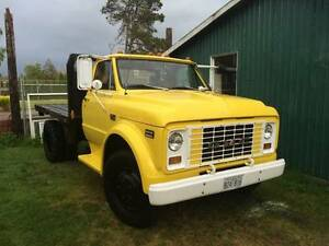 1969 GMC two ton flat deck dump