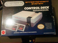 Boxed Nintendo with 3 games