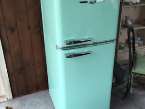 Like new *TEAL* northstar fridge ..paid close to 3500$