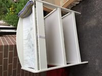 White two shelf changing table