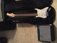 Fender guitar with amp and soft case