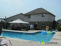Beautiful house with salt water pool, new roof, great location