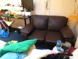 FREE Two seater brown leather sofa