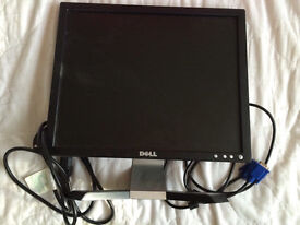 Dell flat screen computer monitor with cables.