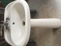 Pedestal Sink with moen single levee faucet.