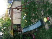 Children's swing set with climbing structure with slide