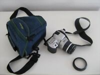 Minolta 35mm camera: 404Si.