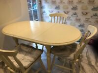 A GREAT QUALITY SOLID WOOD EXTENDING 2/4 SEATER DINING TABLE AND 4 CHAIRS IN GOOD USED CONDITION