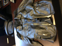 A beautiful women motorcycle jacket. Leather pants and sqirt. SM