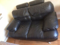 TWO SEATER LEATHER SOFA IN GOOD CONDITION.