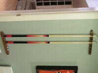 Pool cue wall holder.