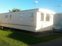 (CANCELLATION DATE AVAILBLE) 6 BERTH CARAVAN TO LET TOWYN NORTH WALES