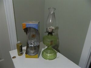 2 Oil Lamps with oil, 1 is brand new in package