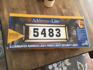 Address o lite with photo cell security light