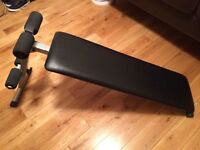 Adjustable abdominal board sit up bench