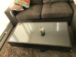 Dark wood glass top coffee table - $25 (SURREY)