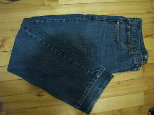 Many pairs of used jeans
