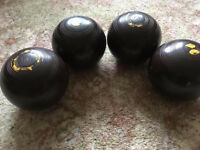 Four bowling green balls