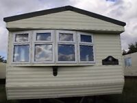 Sited static caravan/ mobile home in North Wales, quiet country site. Very reasonable site rates