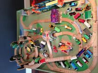 Train table with lots of track and trains