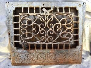 Old Cast iron home heating grill.