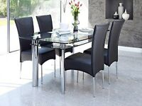 Black and silver glass dining table with 6 chairs