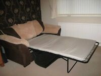 Double Sofa Bed for sale excellent condition brown and beige no room for it