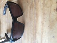 Two pair of Oakley sunglasses