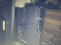 PS3 for sale - includes HDMI cable and 4 new games