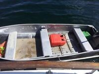 Aluminum boat with a 9.8 engine $1,000.00