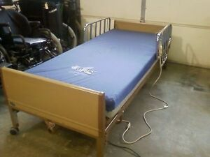 Full electric Invacare Hospital Bed with remote St. John's Newfoundland image 1