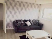 Grey fabric dfs sofa with black leather arms