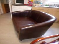 Two seater Sofa like Leather.