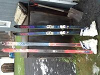 3 pairs of older style skis (2 new never used still in wrapping)