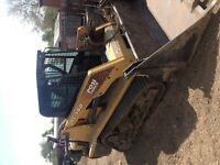 Asv rc 100 track skid steer with 2014 tri axle end dump trailer