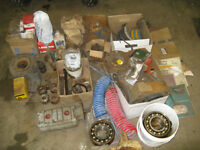 assortment of heavy equipment parts