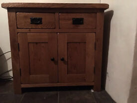 Solid oak two drawer cabinet.