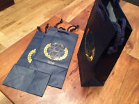 High quality paper/gift bags, two color options, very strong, 220sold