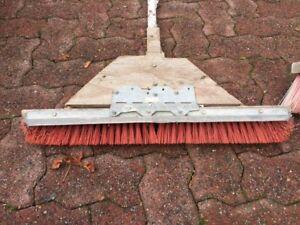 2 heavy duty push brooms