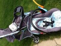 baby items Cosco stroller with carrier.  And some toys